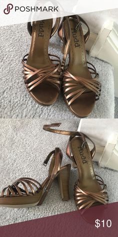 Mudd heels Brown metallic heels, strap warps around ankle. Only worn once for an event, so in great condition Mudd Shoes Heels