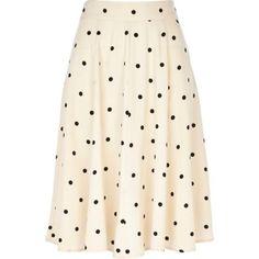 Beige polka dot midi skirt by: River Island