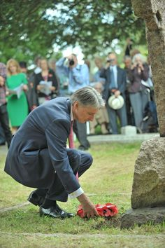 MP Phillip Hammond lays a wreath at the service to remember Flight Lieutenant Robert Skene, who is thought to be one of the first people to die in an aircraft during the First World War