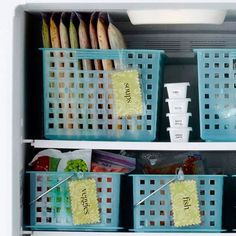 Organize the freezer... look at how pretty that is. Not sure that I have the gusto to get it looking like that, but like the idea of having containers to corral various types of freezer foods in.