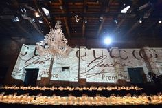 love the projected wall paper on the rustic brick wall and long tables for the gucci premiere at Hotel Cipriani