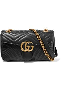 Gucci's 'Marmont' bag is made from black leather that's beautifully quilted with a chevron pattern and heart at the back. It has enough room inside for your cell phone, keys and the matching wallet. We particularly like the burnished gold hardware - a house signature reworked by Creative Director Alessandro Michele.