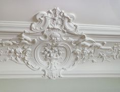 I love vintage crown molding. This remodeled apartment in Paris looks like the perfect place for my three month vacation. (heavy sigh)