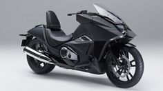 "Honda Builds a Bat Bike  ""The NM4 Vultus with its future-shock style presents a look that will not have been seen in any cityscape this side of an anime movie,"" Hond..."