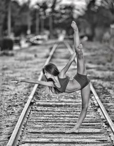 Love pics on train tracks....and this pose makes it even better!