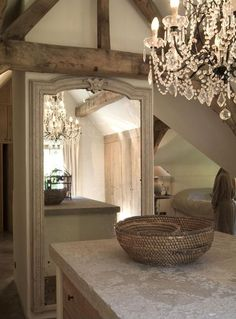 I don't know what I like more! The mirror? The chandelier? The wooden beams?! Gorgeous