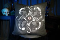 """Tentacular Pillow $30.00 This throw pillow features our hand-drawn """"Tentacular"""" monster on both sides.   The illustration is custom printed on a linen-cotton blend fabric and hand sewn in Oregon, U.S.  The Tentacular pillow is 16"""" x 16""""  with a zipper closure and includes the standard poly insert."""