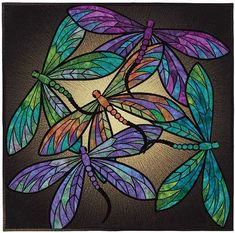 DANCE OF THE DRAGONFLY Kit - Pattern, Panel, Fat Quaters & Black   Make this wall hanging quilt from our kit.  What in the kit: The Pattern The Panel Fat quaters to make the dragon fly wings The black fabric to apply the dragon fly wings to. Binding fabric.