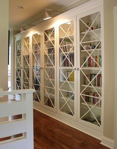 Decorating Bookshelves: 7 Ideas to Make it Interesting | Decorating Files |  To give bookshelves a sleeker more polished look, add glass doors. The doors will also help cut down on your dusting.