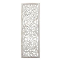 Three scroll medallions with floral center pieces make up the interior of this narrow panel. The hand carved design is white washed for a rustic look.