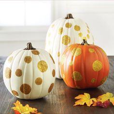 Who could resist these gold glittered polka dot pumpkins! Use multiple colors of glitter for a m...