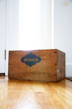 Antique wood crate for shoes by your front door.
