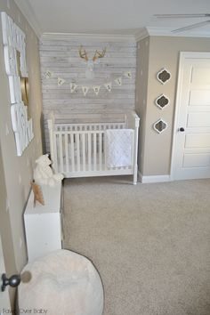 Love the wood wall and faux deer head with gold antlers in this nursery! A perfect setting for our Woodland Deer Baby Bedding