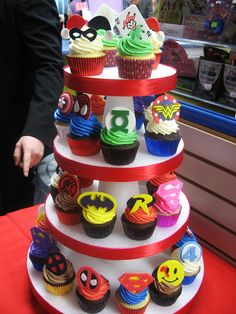The ultimate.  Where to get the toppers?  Robby is sitting over my shoulder flipping out begging me for this cupcake tower for his party.  I do love that there are some pink ones for the girls!