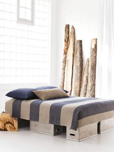 What ARE those things holding up the bed? Cheap? Bed frame idea for us