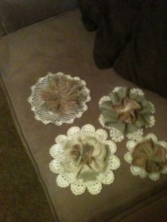 Burlap Flowers with small lace doilies.