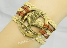 Mockingjay pin braceletGrey leather braceletcharm by charmcover, $7.99