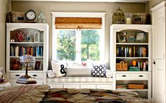 Repurposed wall unit into bookshelves with built in window seat in master bedroom