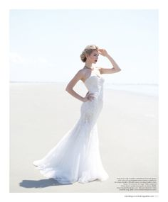 Wedding dress by Monique Lhuillier, vintage 1940s necklace from House of Lavande, ring by  Erickson Beamon. Featured in the Summer 2014 issue of Weddings Unveiled. Photographed on the beach at Seabrook Island in South Carolina.