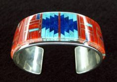 Cuff   Tommy Jackson. Sterling silver, coral, lapis and turquoise.