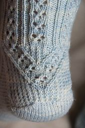 This mystery sock was designed for the Solid Socks group August/September 2013 Mystery KAL and was knit, starting on August 1st, over a period of 4 weeks.