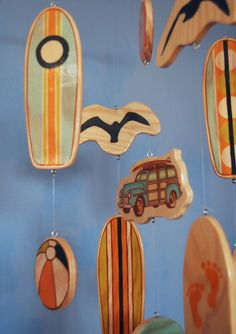 A wooden baby mobile for a bright, beach themed nursery.