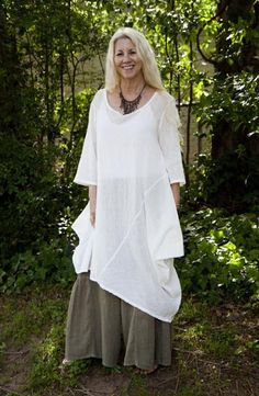"""Don't let age stop you from dressing how you like! This """"mori woman""""'s bright white top layer and casually sleek hair, as well as her modern-looking necklace, ensure that she looks stylishly and deliberately dressed rather than like a bag lady."""