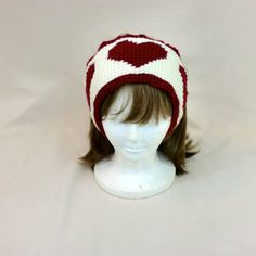 This valentine headband can double as earmuffs and has 3 hearts across it. It is crocheted in red and off white yarn and is sure to keep your #headband #earmuffs #heart #valentine #red #white #hairtie #hair