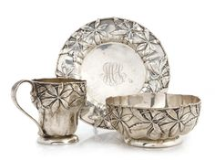 "An American sterling silver Art Nouveau foliate-decorated three-piece place setting by Gorham Mfg. Co., Providence, RI, 1899 Comprising: a mug; a bowl; and a plate (diameter 7 3/4in), the bowl and plate monogrammed ""MCA"""