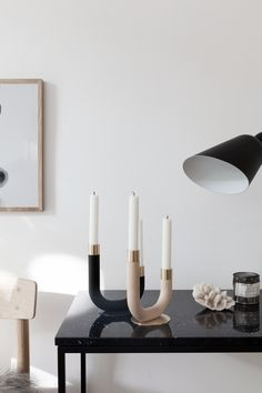 Candle holders with simple shade and  beautiful materials.