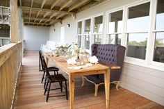 Check out that farm table with vintage chairs and chic bench. #vintageglam
