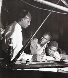 Bassist Oscar Pettiford, Miles Davis and Gil Coggins during a recording session for Blue Note, 1952. Photo by Francis Wolff.