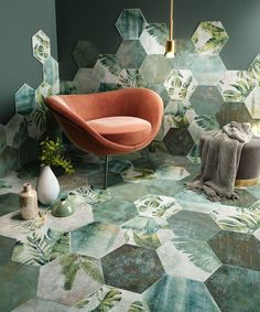 Tiles not only contrast with color and design, but shape. The soft curves of the chair and foot stool butt up against the sharp lines of the hexagonal tiles. Also quite interesting leaf designs on the tiles. Interior Design Living Room, Interior Decorating, Decorating Tips, Green Interior Design, Interior Designing, Interior Walls, Tile Design, Floor Design, Design Bathroom