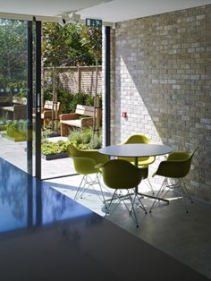Image 10 of 17 from gallery of North London Hospice / Allford Hall Monaghan Morris. Photograph by Allford Hall Monaghan Morris Inside Outside, Eames Chairs, Hospice, North London, Outdoor Furniture Sets, Outdoor Decor, Dezeen, Brick Wall, Exterior