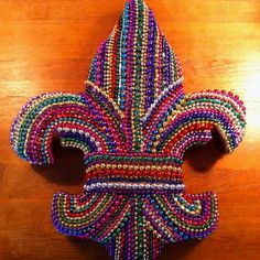 'Tis the season! Fleur de lis hanging decoration made with old Mardi Gras beads'Tis the season! Fleur de lis hanging decoration made with old Mardi Gras beads'Tulane Mardi Gras Bead Tree' Sticker by estollerTulane Mardi Mardi Gras Food, Mardi Gras Carnival, Mardi Gras Parade, Mardi Gras Wreath, Mardi Gras Decorations, Mardi Gras Beads, Bead Crafts, Diy And Crafts, Arts And Crafts