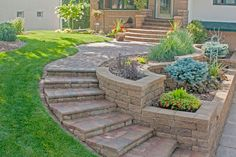 """A curved stairs and tiered areas for shrubs and flowers say """"welcome home!"""""""