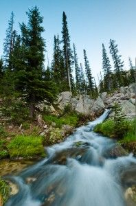 7 Tips for Landscape Photography in the Mountains           Long exposure photograph of a mountain stream              http://improvephotography.com/1793/tips-ideas-landscape-photography-mountains-hiking-camping/
