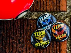 "Pokemon Go Metallic Team Black Background With Instinct/Mystic/Valor Team Names 1.25"" Pin Back Buttons"