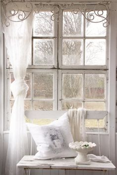 [I love the curlicue trim at the top of the window!!] White winters day