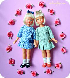 Jennie dolls by Denys Fisher.  They were made in 1976 and originally came dressed in a school uniform.  Now they are wearing some new party dresses I made for them.