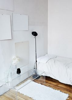 all white bedroom with black floor lamp and lucite coffee table. Small Master Bedroom, Master Bedroom Design, White Bedroom, Grey Bedrooms, Teen Bedroom, Minimalist Bedroom, Minimalist Decor, Minimalist Interior, Ideas Hogar