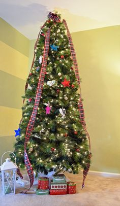 Slim faux Christmas tree decorated with plaid ribbon and DIY fabric ornaments Best Artificial Christmas Trees, Slim Christmas Tree, Tree House Accessories, Christmas Tree Decorations Ribbon, Apple Tree Flowers, Olive Tree Tattoos, Birch Tree Decor, Wishing Tree Wedding, Pine Tree Silhouette