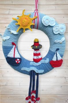Crochet door wreath // door decoration - sea motif DIY, Do you like the sea + pretty door wreaths? Then get the PDF instructions with lots of pictures and start crocheting so that the wreath will be ready s. Crochet Christmas Wreath, Crochet Wreath, Crochet Flowers, Diy Tricot Crochet, Crochet Gifts, Crochet Baby, Crochet Toys, Crochet For Boys, Knitting Patterns Boys
