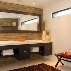 Floating vanity, framed mirror, stone back splash