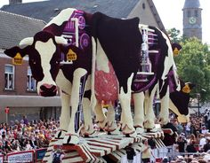 Milk-processing plant within the cow's body made of dahlias for annual flower show, Bloemencorso, in Zundert, Holland. Click through to see more displays.