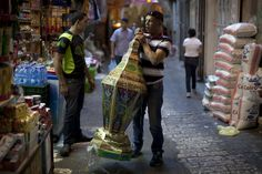 LARGE LANTERN: A Palestinian man walked with a large lantern in Jerusalem's Old City Sunday. Muslims are preparing for the fasting month of Ramadan. (Ahmad Gharabli/Agence France-Presse/Getty Images)