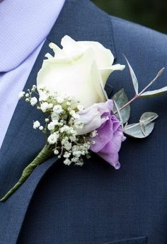 Buttonhole of rose with lisianthus and gypsophila