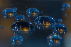 Macro Photographs of Cityscapes and Landmarks Reflected in Water Drops #macro #photography #creativity