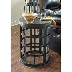 Weave quite the conversation piece into your space with the marimon round end table. A woven industrial basket crafted of metal is topped with distressed wood for a unique mixed media design. Rivet accents incorporate an industrial Heritage Element. Entryway Furniture, Home Office Furniture, Accent Furniture, Dining Room Furniture, Cool Furniture, Round Side Table, End Tables, Living Room Table Sets, Signature Design