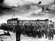Captured in the battle of St. Lo, a group of Nazi prisoners are gathered on a French beach for transfer in the Coast Guards manned LST to England for internment. The group includes Poles, Austrians, and Czechs. They were willing prisoners, but express disappointment when they were sent to England instead of the United States.